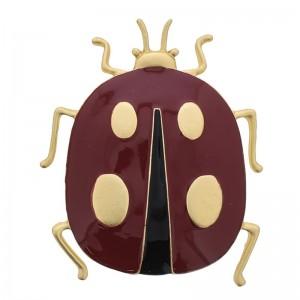 Broche de metal rojo con forma de insecto